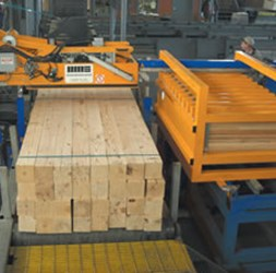 Lumber being bundled on the  PLTS machine.